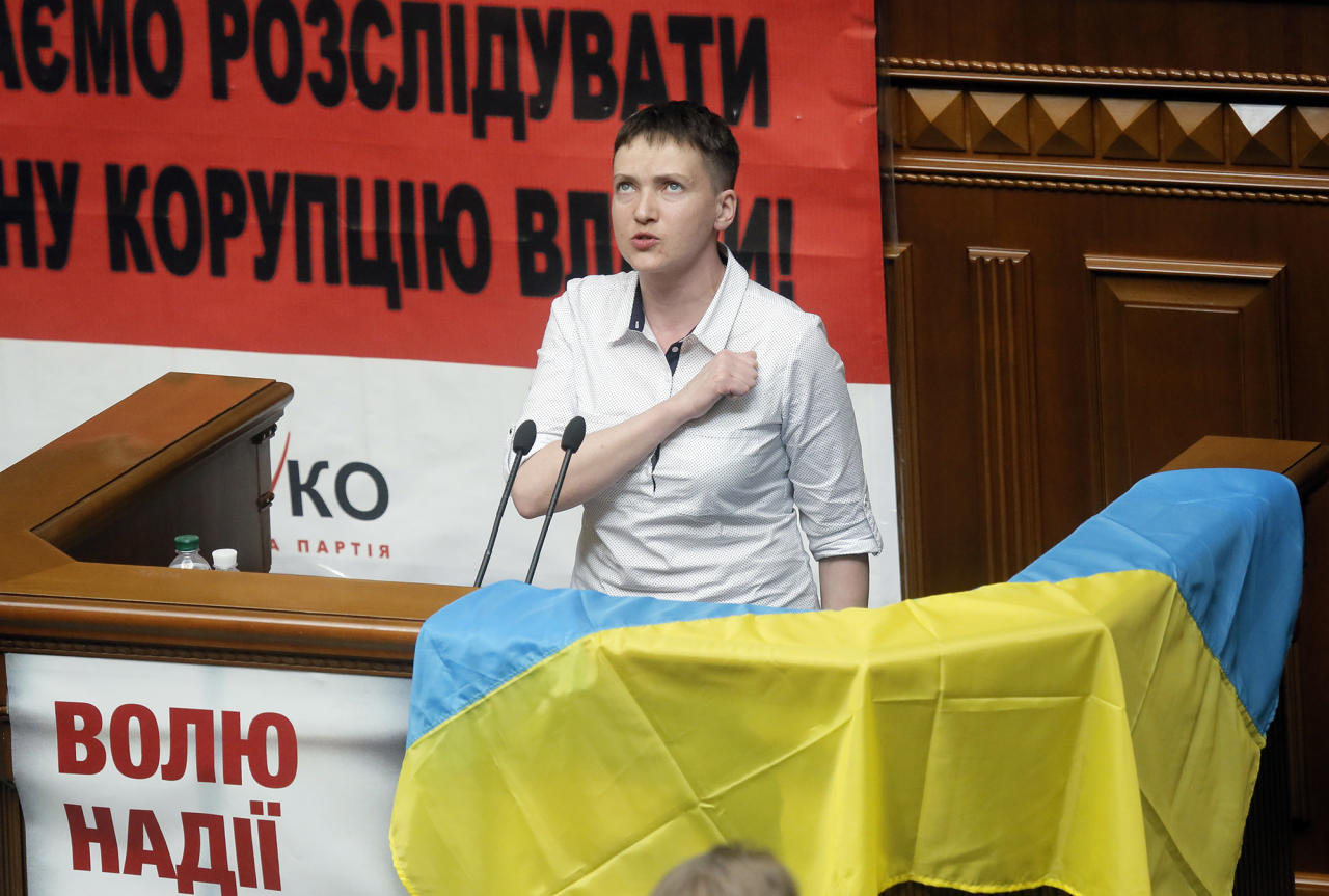 "<p>Ukrainian pilot Nadiya Savchenko, who spent two years as a Russian prisoner, sings the national anthem during the parliament session in Kiev, Ukraine, Tuesday, May 31, 2016. Savchenko appeared for her first session at the Ukrainian parliament as a lawmaker in former Prime Minister Yulia Tymoshenko's party on Tuesday. The poster reads: ""Freedom to Nadezhda Savchenko.""(AP Photo/Efrem Lukatsky) </p>"