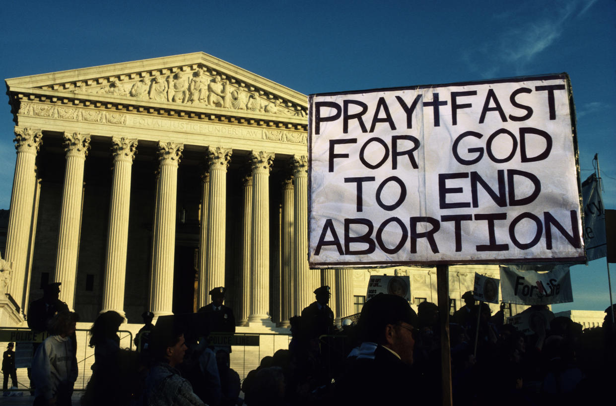 """<span class=""""s1"""">Anti-abortion demonstrators at the Supreme Court. (Photo: Andrew Holbrooke/Corbis via Getty Images)&nbsp;</span>"""