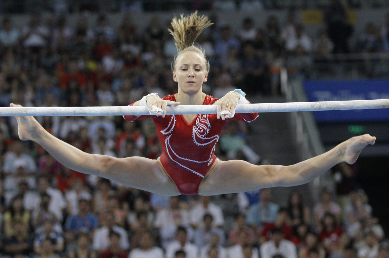 U.S. gymnast Nastia Liukin performs on the uneven bars during the women's gymnastics team finals at the Beijing 2008 Olympics in Beijing, Wednesday, Aug. 13, 2008.  (AP Photo/Amy Sancetta)