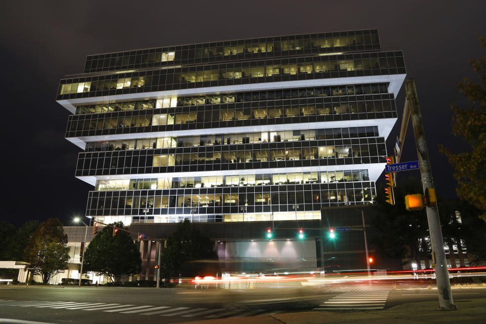 FILE - In this Sept. 12, 2019, file photo, cars pass Purdue Pharma headquarters in Stamford, Conn. The judge overseeing the bankruptcy case of OxyContin maker Purdue Pharma will consider Wednesday, Dec. 4, whether the company's CEO should get a bonus equal to half his $2.6 million salary. Attorneys general representing about half the states say the company's chief executive Craig Landau shouldn't get a bonus, arguing in court filings that he bears some responsibility for the national opioid epidemic that they say the company's signature painkiller helped fuel. (AP Photo/Frank Franklin II, File)