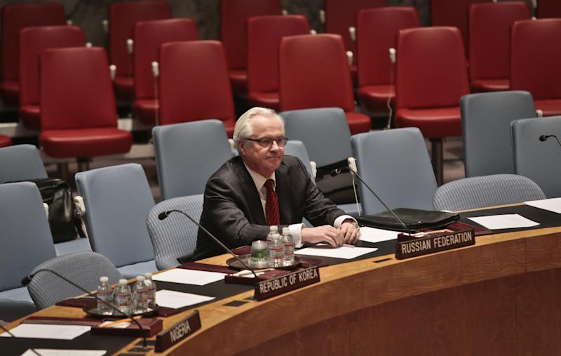 U.N. Russian Ambassador Vitaly Churkin arrives early and is seated alone as he waits for the start of a U.N. Security Council meeting on the crisis in the Ukraine, Wednesday March 19, 2014, at United Nations Headquarters. (AP Photo/Bebeto Matthews)