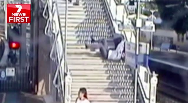 A man rushing to catch the train falls down 25 steps. Source: 7 News