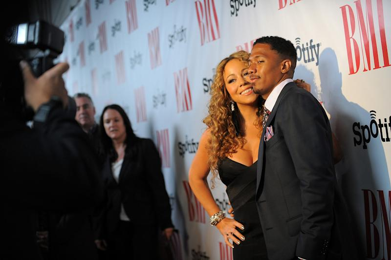 Mariah Carey and her husband Nick Cannon arrive at the BMI Urban Awards on Friday, Sept. 7, 2012 in Beverly Hills, Calif. (Photo by Jordan Strauss/Invision/AP)