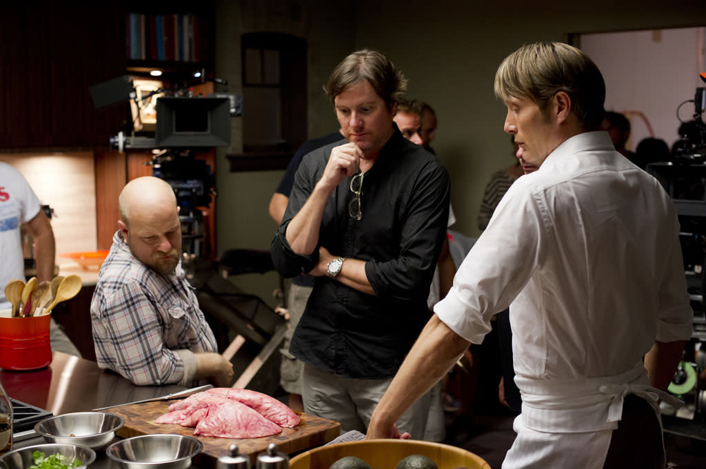 "<p>Welcome to another episode of ""Cooking With Hannibal""! Mikkelsen and the ""Hannibal"" crew contemplate the slab of mystery meat Lecter's about to cook up. But where are the fava beans?</p>"