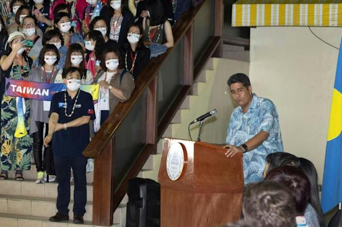 Palau's President Surangel Whipps greets tourists from Taiwan on April 1, 2021 after the allies launch a travel bubble