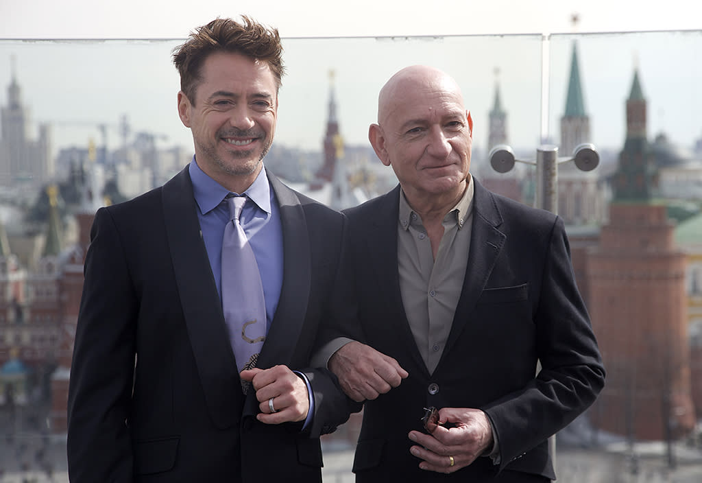 Actors Robert Downey Jr, left, and Ben Kingsley pose during a photo call to promote their new movie Iron Man 3, on the roof of a hotel in Moscow, with Kremlin in the background, on Wednesday, April 10, 2013. (AP Photo/Ivan Sekretarev)