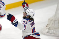 New York Rangers center Mika Zibanejad (93) raises his arms after scoring his second goal of the game during the third period of an NHL hockey game against the Boston Bruins, Saturday, May 8, 2021, in Boston. The Rangers defeated the Bruins 5-4. (AP Photo/Charles Krupa)