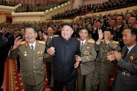 FILE PHOTO: North Korean leader Kim Jong Un reacts during a celebration for nuclear scientists and engineers who contributed to a hydrogen bomb test, in this undated photo released by North Korea's Korean Central News Agency (KCNA)