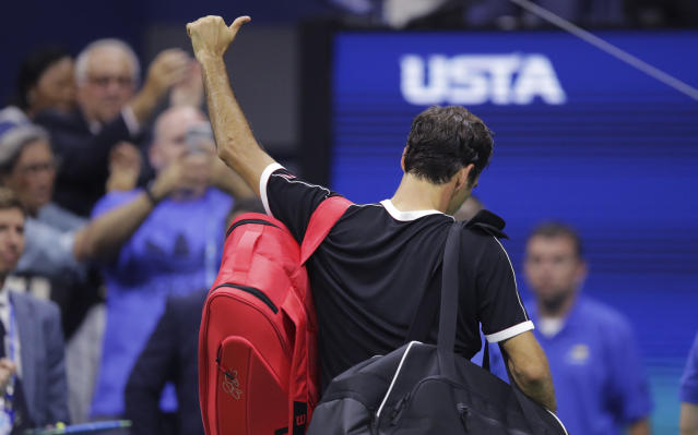 Roger Federer, of Switzerland, flashes a thumbs-up to the crowd after a loss to Grigor Dimitrov, of Bulgaria, during the quarterfinals of the U.S. Open tennis tournament Tuesday, Sept. 3, 2019, in New York. Dimitrov won 3-6, 6-4, 6-3, 6-4, 6-2. (AP Photo/Charles Krupa)