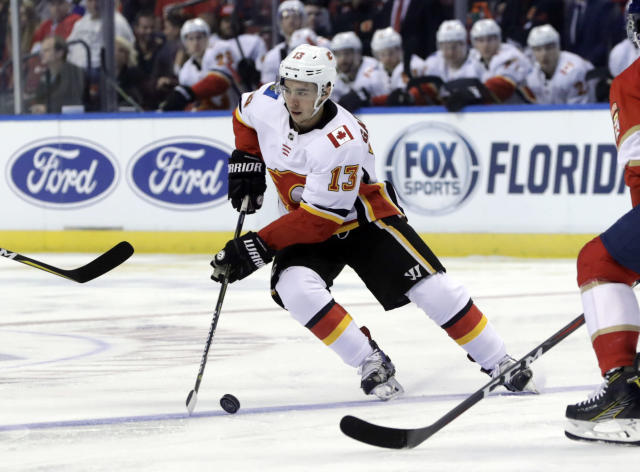 "Calgary Flames left wing <a class=""link rapid-noclick-resp"" href=""/nhl/players/5470/"" data-ylk=""slk:Johnny Gaudreau"">Johnny Gaudreau</a> (13) skates with the puck during the first period of an NHL hockey game. (AP Photo/Lynne Sladky)"