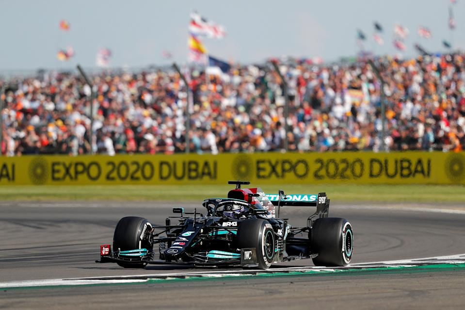 Mercedes' British driver Lewis Hamilton drives during the Formula One British Grand Prix motor race at Silverstone motor racing circuit in Silverstone, central England on July 18, 2021. (Photo by Adrian DENNIS / AFP) (Photo by ADRIAN DENNIS/AFP via Getty Images)