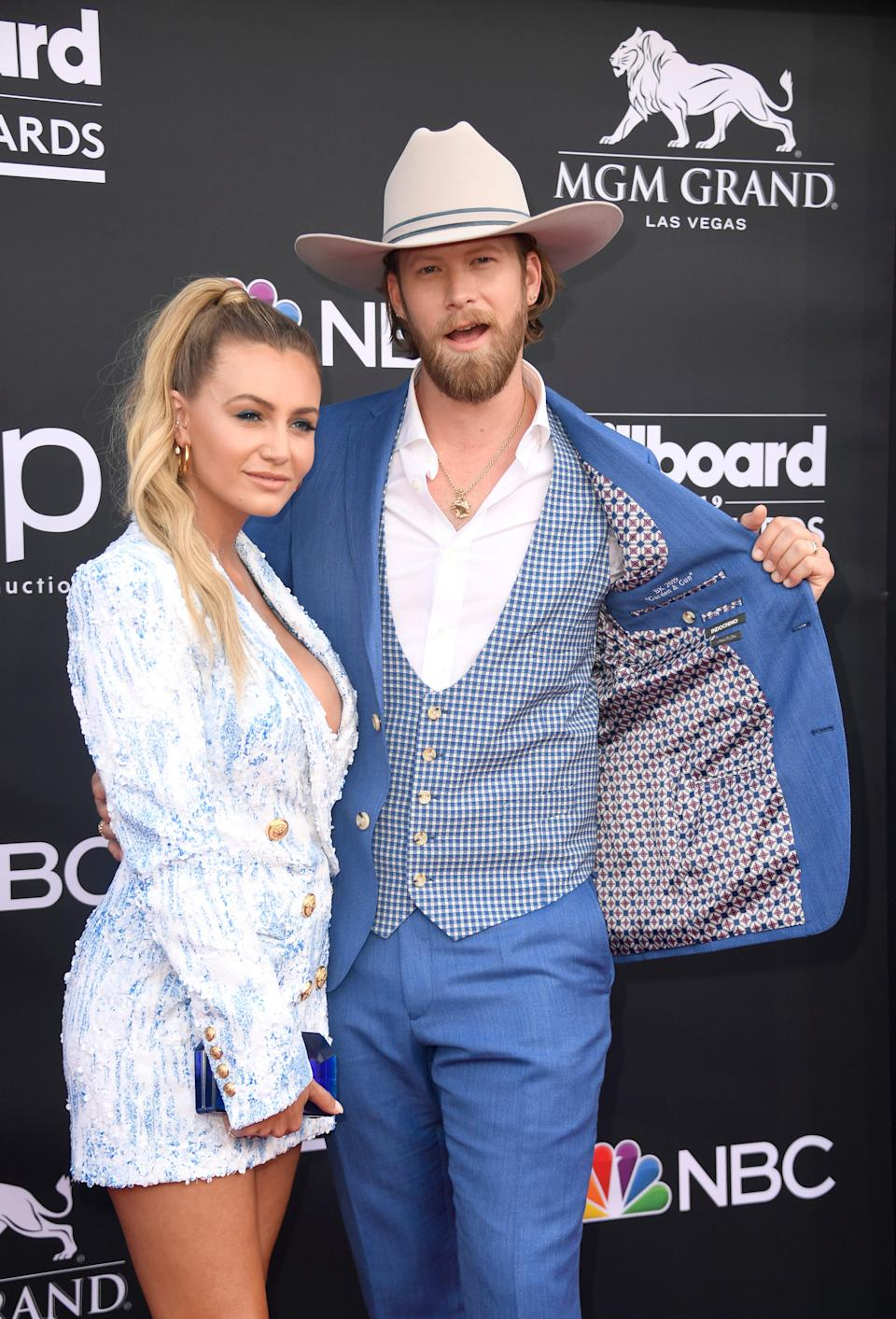Brittney Marie Cole Kelley and Brian Kelley of Florida Georgia Line attend the 2019 Billboard Music Awards at MGM Grand Garden Arena on May 01, 2019 in Las Vegas, Nevada.