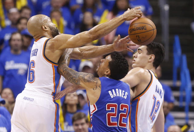 Oklahoma City Thunder guard Derek Fisher (6) reaches for a rebound over Los Angeles Clippers forward Matt Barnes (22) in the fourth quarter of Game 2 of the Western Conference semifinal NBA basketball playoff series in Oklahoma City, Wednesday, May 7, 2014. Oklahoma City won 112-101. Thunder center Steven Adams (12) is at right. (AP Photo/Sue Ogrocki)