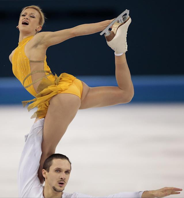 Tatiana Volosozhar and Maxim Trankov of Russia compete in the pairs free skate figure skating competition at the Iceberg Skating Palace during the 2014 Winter Olympics, Wednesday, Feb. 12, 2014, in Sochi, Russia. (AP Photo/Ivan Sekretarev)