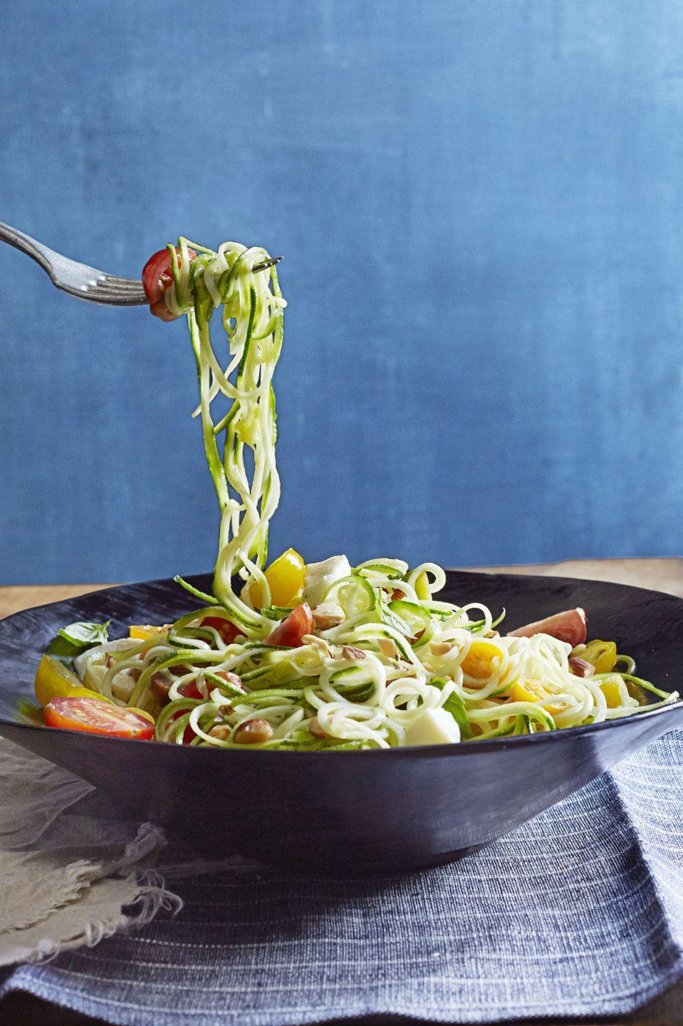 """<p>Reason #857,396 you should invest in a <a href=""""https://www.goodhousekeeping.com/food-recipes/healthy/a21651/spiralizer-spiraled-vegetables/"""" rel=""""nofollow noopener"""" target=""""_blank"""" data-ylk=""""slk:spiralizer"""" class=""""link rapid-noclick-resp"""">spiralizer</a>: this decadent """"pasta"""" dish. </p><p><em><a href=""""https://www.goodhousekeeping.com/food-recipes/a15908/zucchini-pasta-caprese-recipe-ghk1014/"""" rel=""""nofollow noopener"""" target=""""_blank"""" data-ylk=""""slk:Get the recipe for Zucchini &quot;Pasta&quot; Caprese »"""" class=""""link rapid-noclick-resp"""">Get the recipe for Zucchini """"Pasta"""" Caprese »</a></em> </p>"""