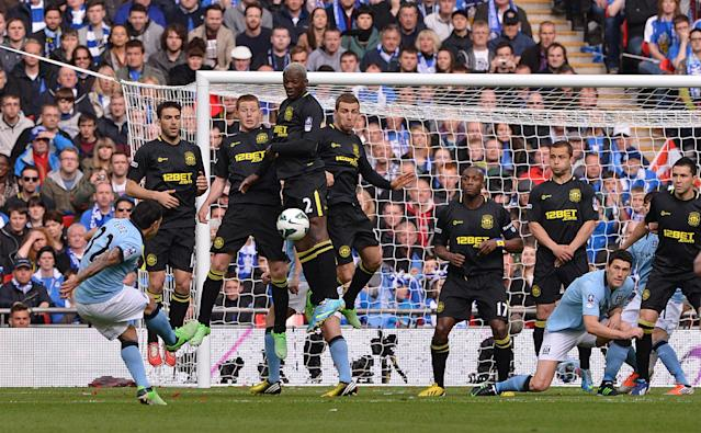 Manchester City's Carlos Tevez shoots from a free-kick