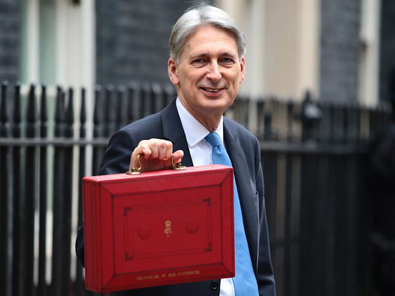 Philip Hammond holds the red case as he departs 11 Downing Street to deliver his budget: Getty Images
