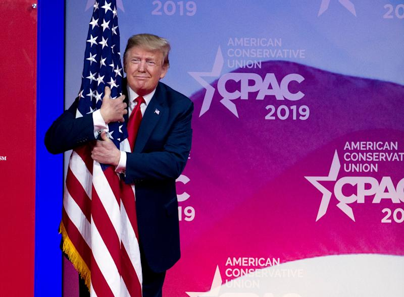 President Donald Trump hugs the American flag as he arrives to speak at Conservative Political Action Conference, CPAC 2019, in Oxon Hill, Md., March 2, 2019. (Photo: Jose Luis Magana/AP)