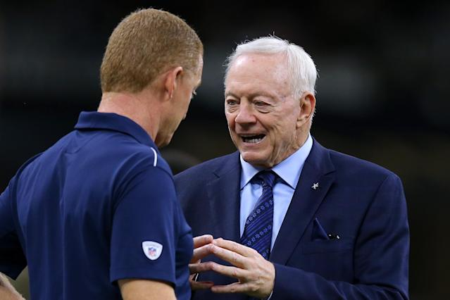 Dallas Cowboys team owner/general manager Jerry Jones, right, said he will not fire head coach Jason Garrett, left, during the season. (Jonathan Bachman/Getty Images)