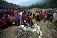 Some 51 people were buried by the mudslides that devastated Queja in Guatemala, turning it into a cemetery