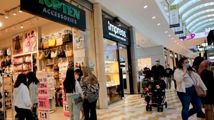 People visit a shopping mall in Modiin, Israel, since covid restrictions were lifted