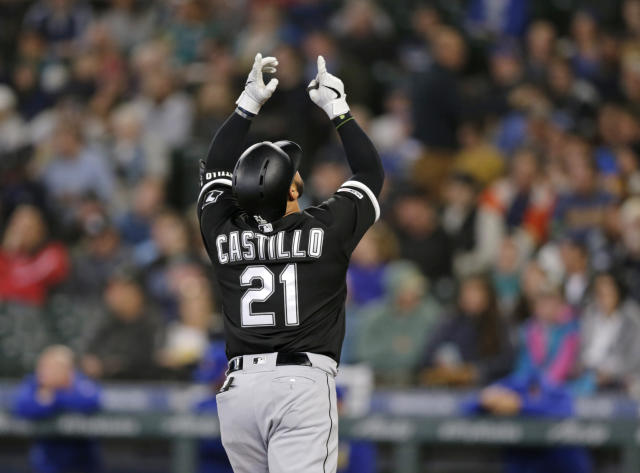Chicago White Sox's Welington Castillo points skyward as he reaches home plate after hitting a grand slam off a pitch from Seattle Mariners relief pitcher Brandon Brennan during the fifth inning of a baseball game Sunday, Sept. 15, 2019, in Seattle. (AP Photo/John Froschauer)