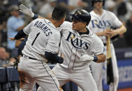 Tampa Bay Rays' Ji-Man Choi, center, celebrates with Willy Adames (1) after hitting a solo home run off New York Yankees' Domingo German during the fifth inning of a baseball game Friday, May 10, 2019, in St. Petersburg, Fla. (AP Photo/Steve Nesius)