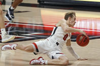 Texas Tech's Mac McClung (0) falls down while dribbling down the court during the first half of an NCAA college basketball game against Incarnate Word, Tuesday, Dec. 29, 2020, in Lubbock, Texas. (AP Photo/Brad Tollefson)