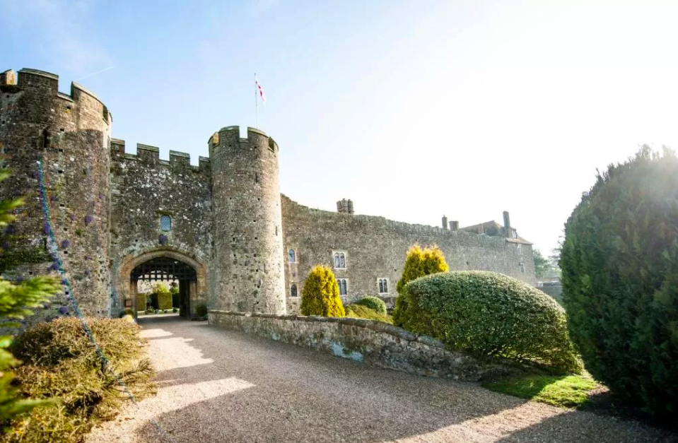 """<p>At 900-years-old, <a href=""""https://www.redescapes.com/offers/west-sussex-arundel-amberley-castle"""" rel=""""nofollow noopener"""" target=""""_blank"""" data-ylk=""""slk:Amberley Castle"""" class=""""link rapid-noclick-resp"""">Amberley Castle</a> was actually recorded in the Domesday Book - which isn't something many hotels can claim. With a working portcullis - still lowered each night - the 60-foot high walls at this castle hotel may look intimidating but they actually enclose a comfortable and cosy retreat.</p><p>Rooms range between contemporary and more 'conventional castle', but the suits of armour positioned around the structure mean that even guests in more modern rooms can't miss the regal theme.<br></p><p>Dinner is served in a domed room decorated with coats of arms and throne-like, steel-studded chairs. </p><p><a href=""""https://www.redescapes.com/offers/west-sussex-arundel-amberley-castle"""" rel=""""nofollow noopener"""" target=""""_blank"""" data-ylk=""""slk:Read our review of Amberley Castle"""" class=""""link rapid-noclick-resp"""">Read our review of Amberley Castle</a></p><p><a class=""""link rapid-noclick-resp"""" href=""""https://www.redescapes.com/offers/west-sussex-arundel-amberley-castle"""" rel=""""nofollow noopener"""" target=""""_blank"""" data-ylk=""""slk:CHECK OUT OUR OFFER"""">CHECK OUT OUR OFFER</a></p>"""