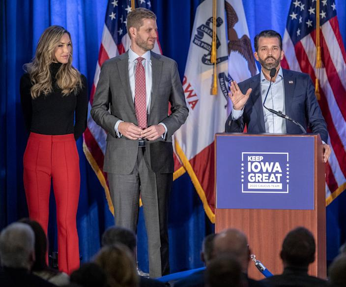 Donald Trump Jr., flanked by his brother Eric Trump, and Eric's wife Lara Trump at a Caucus Day event in West Des Moines, Iowa, Monday, Feb. 3, 2020. Democrats and Republicans caucus on the same day in the Hawkeye state.