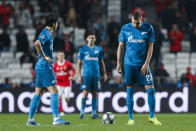 Zenit's Artem Dzyuba, right, stands next to the ball after Benfica's Franco Cervi scored the opening goal during the Champions League group G soccer match between Benfica and Zenit St. Petersburg at the Luz stadium in Lisbon, Tuesday, Dec. 10, 2019. (AP Photo/Armando Franca)