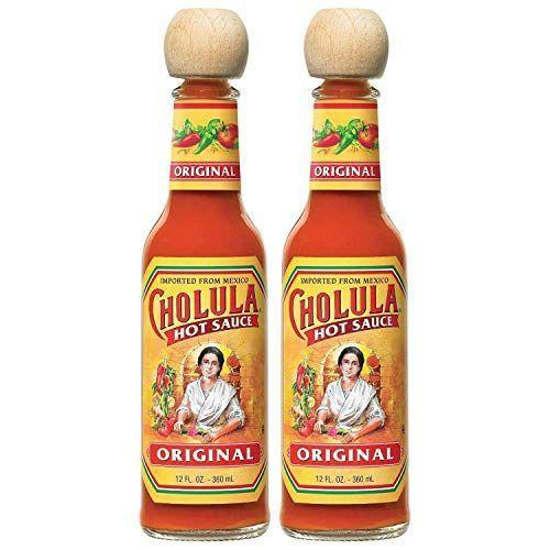 "<p><strong>Cholula</strong></p><p>amazon.com</p><p><strong>$11.99</strong></p><p><a href=""https://www.amazon.com/dp/B00PACY7B6?tag=syn-yahoo-20&ascsubtag=%5Bartid%7C10067.g.32949392%5Bsrc%7Cyahoo-us"" rel=""nofollow noopener"" target=""_blank"" data-ylk=""slk:Shop Now"" class=""link rapid-noclick-resp"">Shop Now</a></p><p>A blend of arbol and piquin peppers lend this popular hot sauce extra nuance. Its flavor and texture make it a good pair for setting off richer foods like pizza and burgers. </p>"