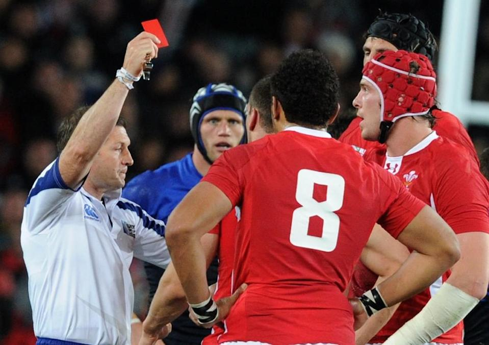 Referee Alain Rolland shows a red card to Welsh forward Sam Warburton (not pictured) during the 2011 Rugby World Cup semi-fianl against France in Auckland (AFP Photo/Gabriel Bouys)