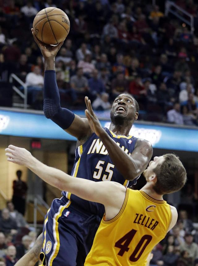 Indiana Pacers' Roy Hibbert (55) jumps to the basket against Cleveland Cavaliers' Tyler Zeller (40) during the first quarter of an NBA basketball game Sunday, Jan. 5, 2014, in Cleveland. (AP Photo/Tony Dejak)