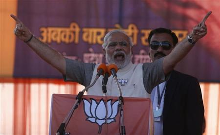Narendra Modi, prime ministerial candidate for Bharatiya Janata Party (BJP), gestures as he address a rally in Gurgaon on the outskirts of New Delhi April 3, 2014. REUTERS/Adnan Abidi