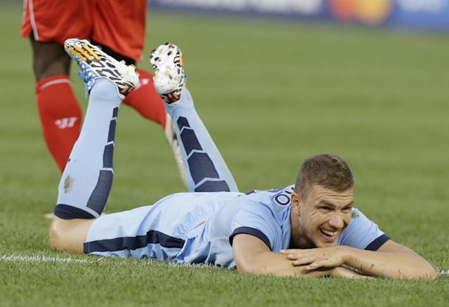 Manchester City's Edin Dzeko (10) reacts to a play in the first half of a Guinness International Champions Cup soccer tournament match against the Liverpool Wednesday, July 30, 2014, in New York. (AP Photo/Frank Franklin II)