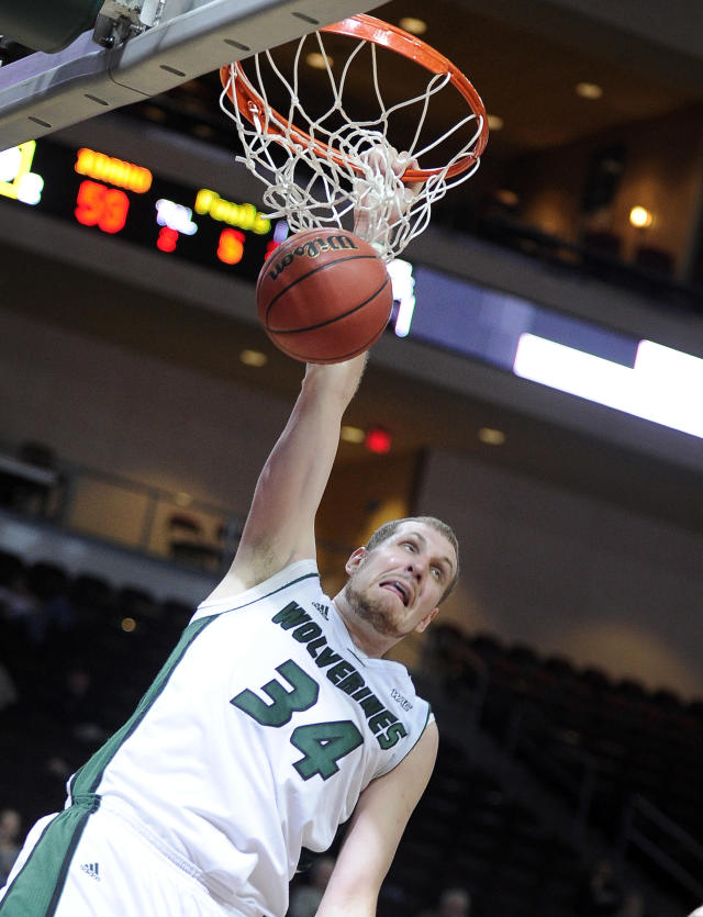 Utah Valley's Ben Aird dunks the ball during the second half of an NCAA college men's basketball game against Idaho in the semifinals of the West Athletic Conference tournament Friday, March 14, 2014, in Las Vegas. Idaho won 74-69. (AP Photo/David Becker)