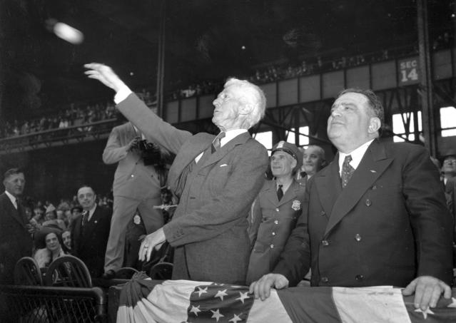 FILE - In this Oct. 1, 1941, file photo, Kenesaw Mountain Landis, baseball commissioner, throws out the first ball, formally opening the 1941 World Series featuring the Brooklyn Dodgers and the New York Yankees at Yankee Stadium in New York on Oct. 1, 1941. New York Mayor Fiorello La Guardia is at right. Landis' name and image are on the National League and American League Most Valuable Player trophies. (AP Photo, File)
