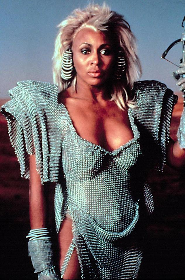"<a href=""http://movies.yahoo.com/movie/contributor/1800047658"">Tina Turner</a>, ""<a href=""http://movies.yahoo.com/movie/1800091730/info"">Mad Max Beyond Thunderdome</a>""<br><br>A tyrannical Tina Turner dresses in post-apocalyptic garb to preside over bloody battles that take place in the deadly Thunderdome as ""We Don't Need Another Hero"" erupts. Need we say more?"