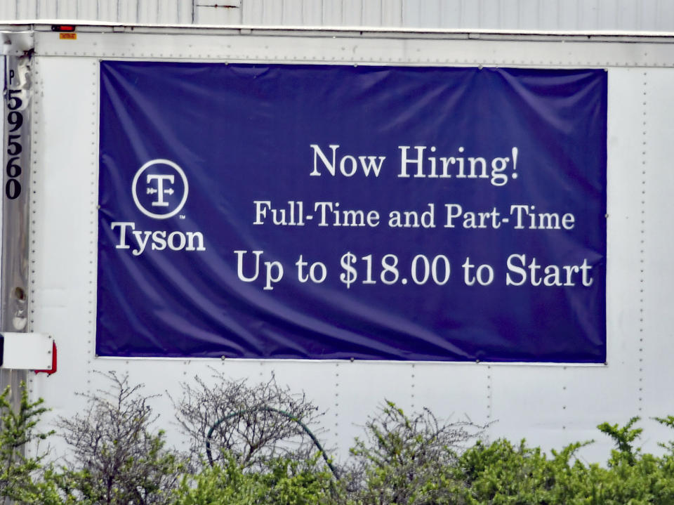 EMPORIA, KS - MAY 6: Now hiring signs in both English and Spanish are posted around the entrance to the Tyson fresh meats plant in Emporia, Kansas as businesses look to hire employees and increase normal production after the COVID-19 pandemic on May 6, 2021. Credit: Mark Reinstein/MediaPunch /IPX