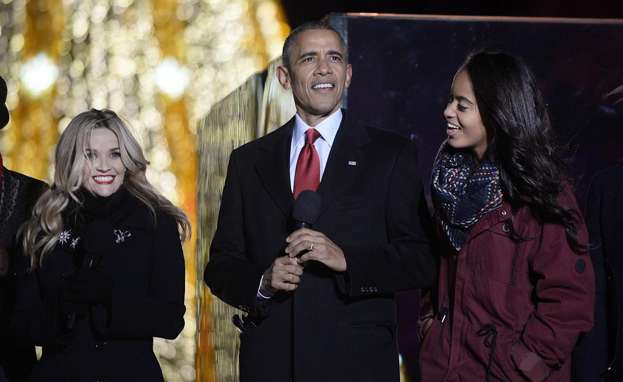 <p>Witherspoon grins next to Obama and his daughter Malia at the National Christmas Tree lighting ceremony at the White House in 2015.</p>