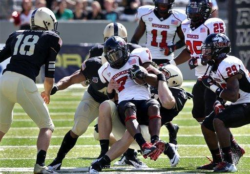 Northern Illinois' Perez Ashford is taken down by Army defenders during the second half in an NCAA college football game in West Point, N.Y., on Saturday, Sept. 15, 2012. (AP Photo/Craig Ruttle)