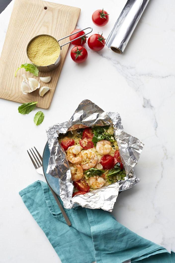 "<p>Go Mediterranean with these easy shrimp foil packets.</p><p><em><a href=""https://www.womansday.com/food-recipes/food-drinks/recipes/a55761/shrimp-and-garlicky-tomatoes-with-kale-couscous-recipe/"" rel=""nofollow noopener"" target=""_blank"" data-ylk=""slk:Get the Shrimp and Garlicky Tomatoes with Kale Couscous recipe."" class=""link rapid-noclick-resp"">Get the Shrimp and Garlicky Tomatoes with Kale Couscous recipe.</a></em></p>"
