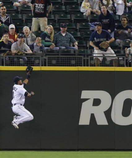 Seattle Mariners center fielder Franklin Gutierrez makes a leaping catch of a ball hit by Oakland Athletics' Jed Lowrie in the first inning of a baseball game, Sunday, June 23, 2013, in Seattle. (AP Photo/Ted S. Warren)