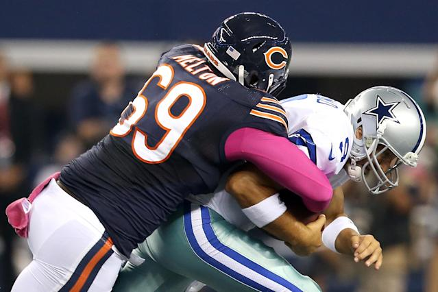 ARLINGTON, TX - OCTOBER 01: Henry Melton #69 of the Chicago Bears sacks quarterback Tony Romo #9 of the Dallas Cowboys in the first quarter at Cowboys Stadium on October 1, 2012 in Arlington, Texas. (Photo by Ronald Martinez/Getty Images)