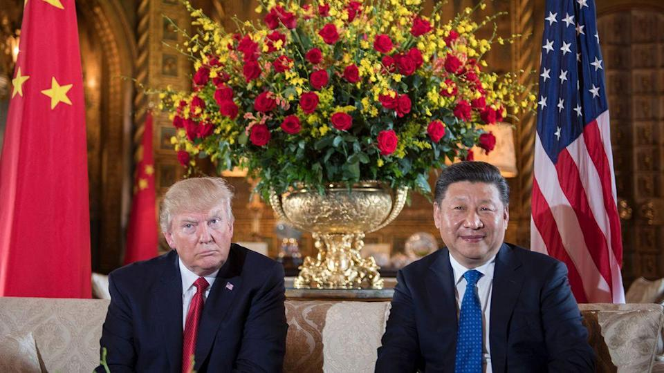 US President Donald Trump (L) sits with Chinese President Xi Jinping (R) during a bilateral meeting at the Mar-a-Lago estate in West Palm Beach, Florida, on April 6, 2017. (JIM WATSON/AFP/Getty Images)
