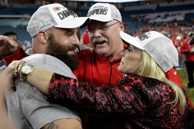 Kansas City Chiefs head coach Andy Reid, center, celebrates with wife Tammy, right, and Travis Kelce after the NFL Super Bowl 54 football game against the San Francisco 49ers, Sunday, Feb. 2, 2020, in Miami Gardens, Fla. The Kansas City Chiefs won 31-20. (AP Photo/Patrick Semansky)