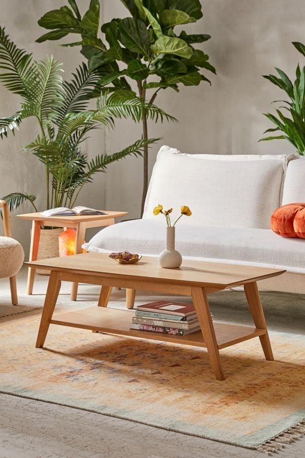 "<p>We love that <a href=""https://www.popsugar.com/buy/Mabel%20Coffee%20Table-469859?p_name=Mabel%20Coffee%20Table&retailer=urbanoutfitters.com&price=179&evar1=casa%3Aus&evar9=46396796&evar98=https%3A%2F%2Fwww.popsugar.com%2Fhome%2Fphoto-gallery%2F46396796%2Fimage%2F46396822%2FMabel-Coffee-Table&list1=shopping%2Csales%2Curban%20outfitters%2Chome%20decor%2Csale%20shopping%2Chome%20shopping&prop13=mobile&pdata=1"" rel=""nofollow"" data-shoppable-link=""1"" target=""_blank"" class=""ga-track"" data-ga-category=""Related"" data-ga-label=""https://www.urbanoutfitters.com/shop/mabel-coffee-table?category=furniture-sale&amp;color=020&amp;type=REGULAR"" data-ga-action=""In-Line Links"">Mabel Coffee Table</a> ($179, originally $199) has an extra shelf.</p>"