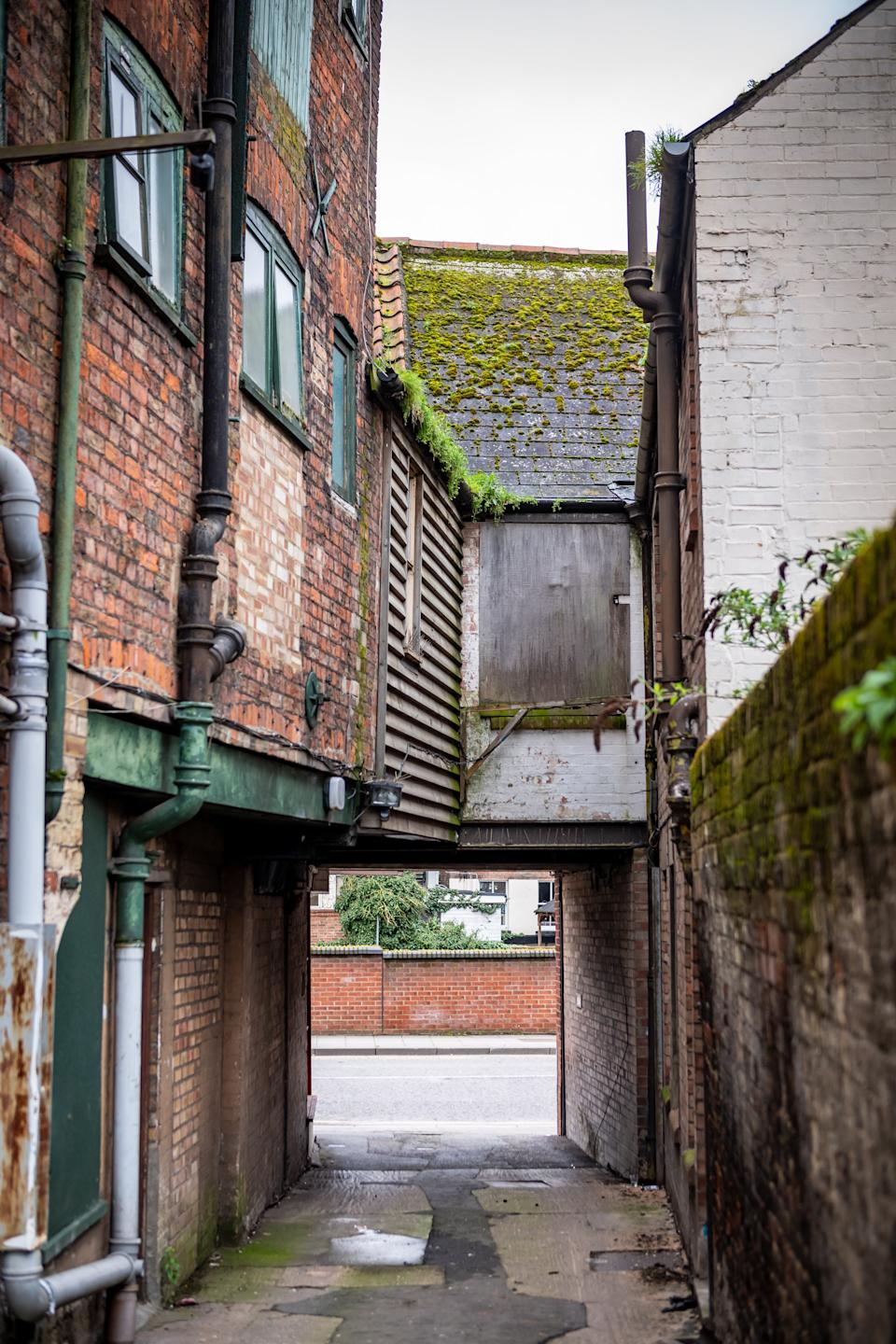 The room is above an alleyway (Picture: SWNS)
