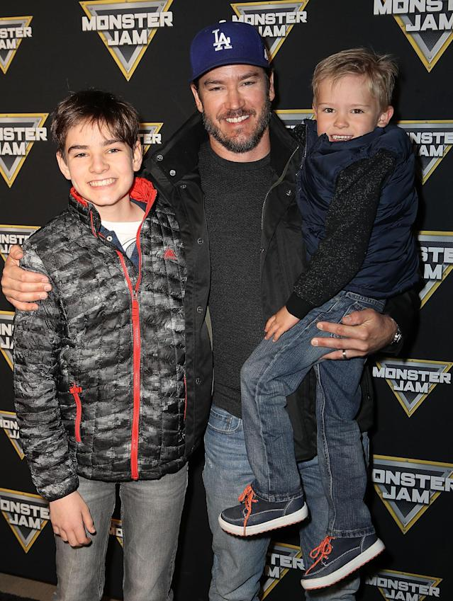 <p>The <em>Saved by the Bell</em> alum brought two of his four kids — sons Michael and Dekker — to the truck show. His two daughters apparently weren't having it. (Photo: Ari Perilstein/Getty Images for Feld Entertainment) </p>